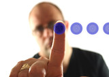 man pressing blue button 4 poster