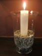 Lit candle in a bell glass. Decoration