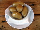 food. nutrition. new potatoes in a dish poster