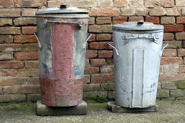 two old trash cans