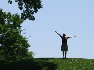 woman reaching to the sky