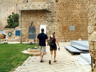 tourists walking beside  acre castle in israel