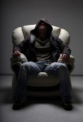 dangerous man sitting in white chair