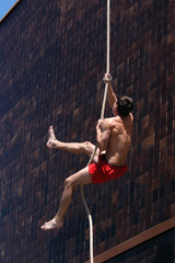 athlete climbing up the rope