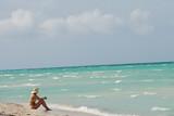 woman enjoying solitude on beach poster