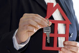 hand hold a key and a house poster