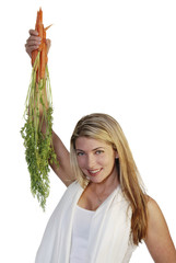 beautiful woman holding up carrots