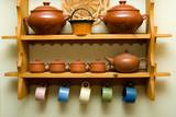ceramic utensils on a wooden shelf poster