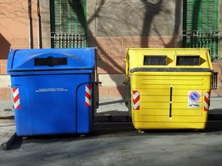 blue and yellow wheelie bins