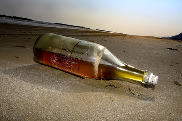 bottle abandoned on the beach