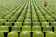 green stadium seats with female spectator