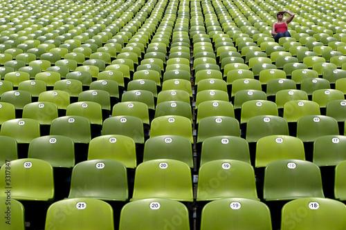 green stadium seats with female spectator