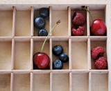 berries and cherries in compartments