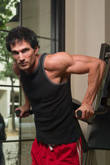 man exercising arm muscles 2