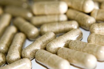 long beige pills