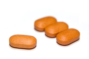 four orange vitamin c tablets