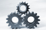 three gears with white backdrop poster