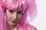 pink wig looking down poster