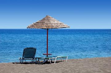 black beach with umbrella - wide