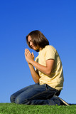 youth kneeling praying, christian faith poster