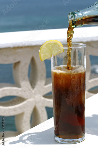 glass of cola on terrace
