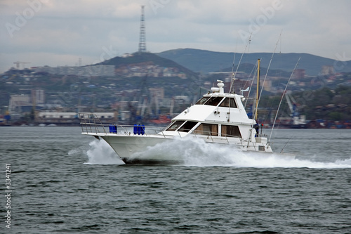 motorboat speeding along golden horn bay