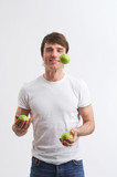 juggling green apples