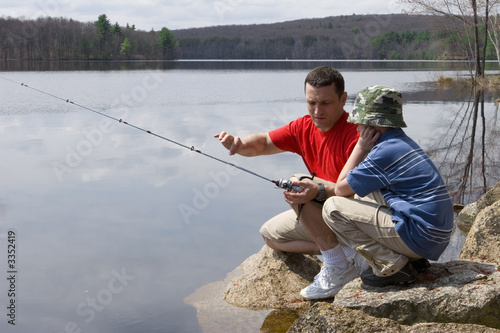 father and son fishing - 3352419