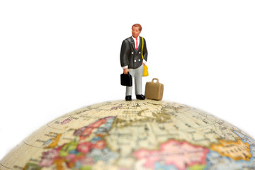 businessman stands on a globe