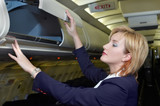 stewardess checking luggage box poster