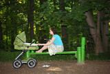 mother with baby carriage poster