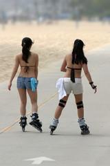 girls skating on the beach
