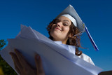 young graduate girl with heap of papers poster