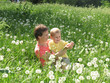 child and mother on dandelion meadow