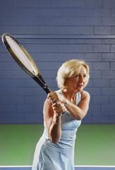 senior health and fitness forehand tennis swing