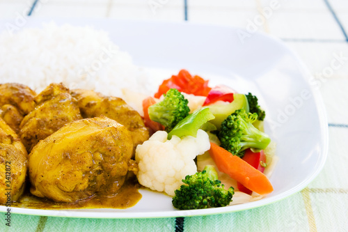 curried chicken with rice and vegetables - jamaica