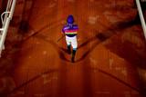 jockey walking to the parade ring poster