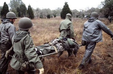 troops carrying comrade on stretcher