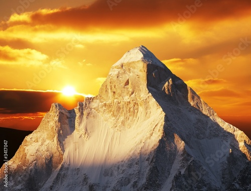 Leinwanddruck Bild shivling peak on sunset