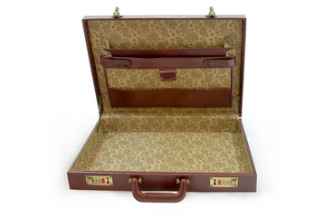 Opened brown business suitcase - isolated