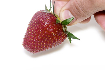 hand with strawberry