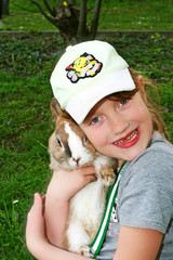 Smiling girl with pet