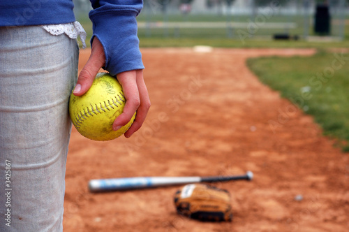 a girl and her softball, glove, and bat - 3425867