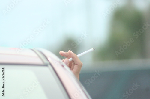 cigarette held  from car window