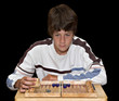 boy playing backgammon