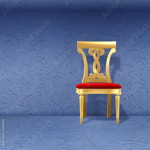 golden royal chair against wall