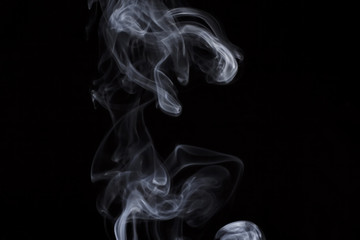 puff of aroma smoke on a dark background