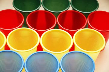 plastic cups of various colours in rows