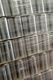 industrial packaging - pallet of metal cans poster