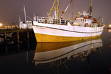 Fishing boat at night in Norway poster